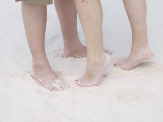 pink sand bahamas feet