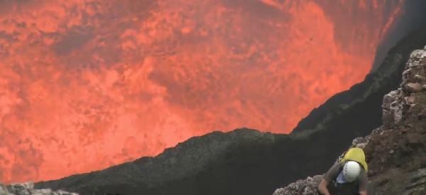 climbing down active volcano