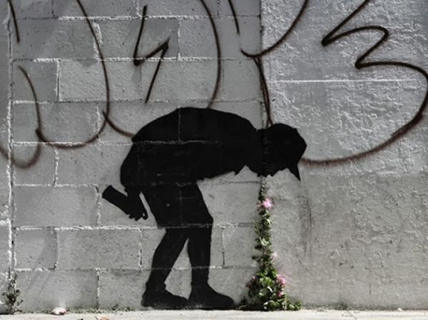 banksy-graffiti-throwing-up-flowers