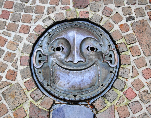 unusual street art of japan turned into a work of art by sewers