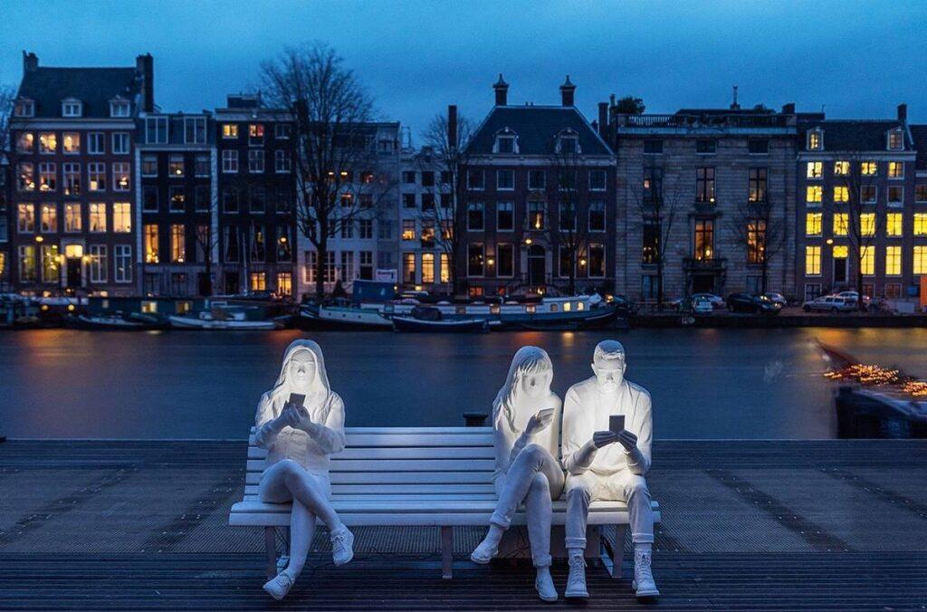 Addiction statue Amsterdam phones