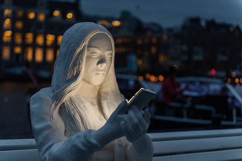 Absorbed by light statue Amsterdam