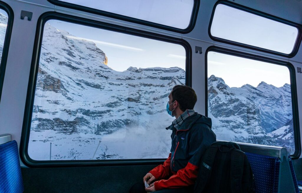 travel train snow mountain peaks
